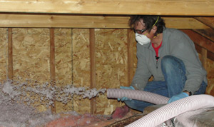 Insualtion being blown into an attic