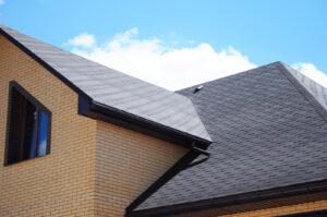 Gray shingle roof on a brick house